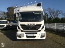 Voir les photos Camion Iveco Stralis AT190S31 HI ROAD TAUTLINER HAYON