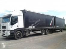 Lastbil med släp Iveco Stralis 260 S 43 flexibla skjutbara sidoväggar skjutbart presenningssystem begagnad