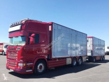 Ciężarówka z przyczepą do transportu zwierząt używana Scania R 580