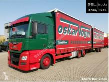 Camión remolque MAN TGX 24.400 6x2-4 LL-U/Lenkachse/Hubd./Int./komp tautliner (lonas correderas) usado