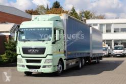 Lastbil med släp MAN TGX 26.480 EEV XLX Retarder/Durchlade/ZUG! skjutbara ridåer (flexibla skjutbara sidoväggar) begagnad