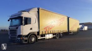 Kamion s návěsem savojský posuvný plachtový systém Scania R 450