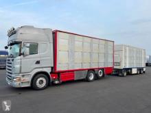 Lastbil med släp boskapstransportvagn Scania R 560