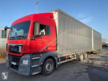 MAN függönyponyvaroló nyerges vontató és pótkocsi TGX 26.480