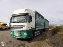 Lastbil med släp DAF XF105 460 flexibla skjutbara sidoväggar flak häckar med presenning begagnad