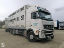 Tractora semi Volvo FH 500 remolque ganadero para ganado porcino usada