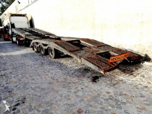 Semirremolque Montenegro Transporte de Camiões portamáquinas usado
