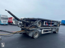 Trax hook arm system trailer