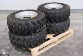 10-16.5 Banden met velgen used Tyres