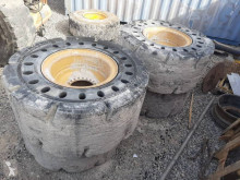 Caterpillar handling part used tyres
