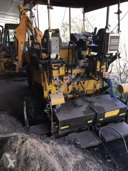 Просмотреть фотографии Дорожно-строительная техника Caterpillar AP300